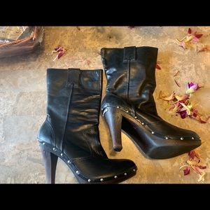 Michael Kors shin high boots with silver detail.